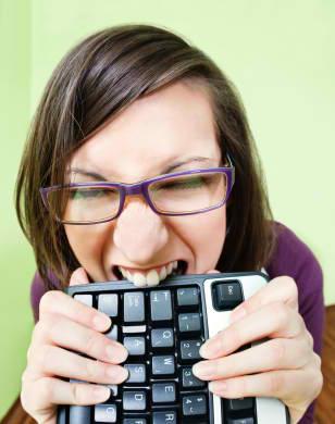 Istock_000008859868xsmall-frustrated-at-job-woman-biting-keyboard